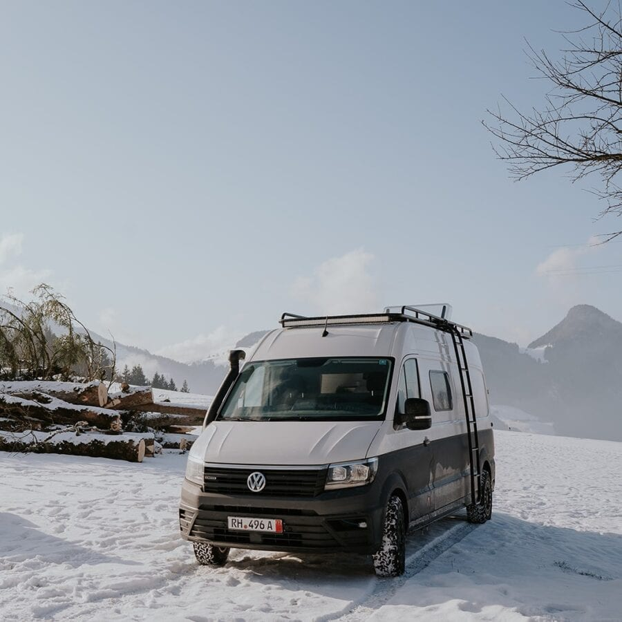 A campervan in a snowy alpine location